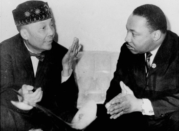 Dr. Martin Luther King, Jr., right, pictured in his first meeting with Elijah Muhammad, left, head of the Black Muslims, said February 24, 1966, in Chicago, IL, his visit does not mean they have a common front. King said Elijah Muhammad agreed a movement is needed against slum conditions. Photo: AP/Wide World photos