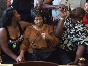 Terina Allen, sister of Samuel DuBose, sits with family members as she reacts in the courtroom following the arraignment of former University of Cincinnati police officer Ray Tensing at Hamilton County Courthouse for the shooting death of motorist DuBose. Photos: AP World Wide Photo