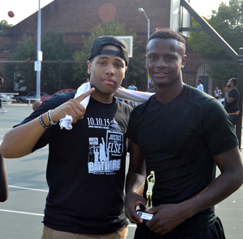 Isaiah Muhammad poses with the winner of the Dunk Contest in Baltimore's Ballin' 4 Justice.
