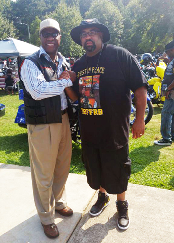 Left to right, Tony Muhammad Western Region Student Minister of the Nation of Islam and Erroll Markham of the Rare Breed Motorcycle Club.